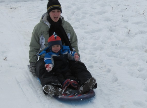 Sarah and Bryson sledding